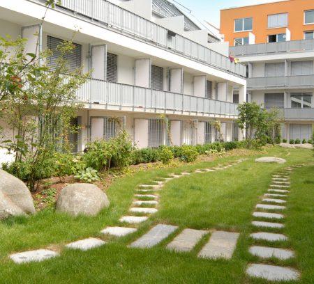 Apartmenthaus studiosus 3 in München mit Studentenapartments mit geomagnetischer Gartengestaltung durch das Architekturbüro atelier8 in Frankfurt
